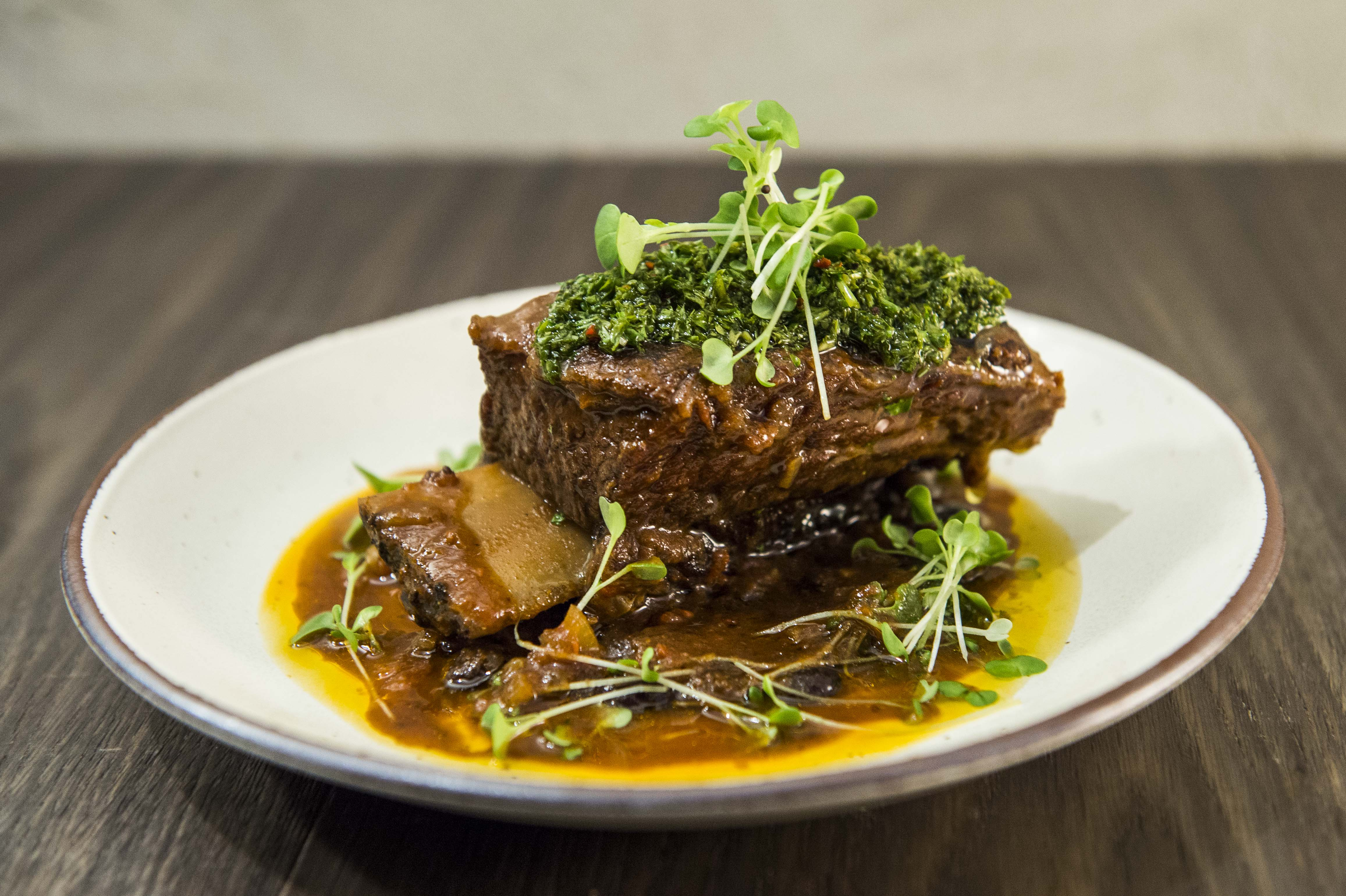 Costillas de Res - Tomato braised Black Angus beef short rib w/ chimichurri and black turtle bean