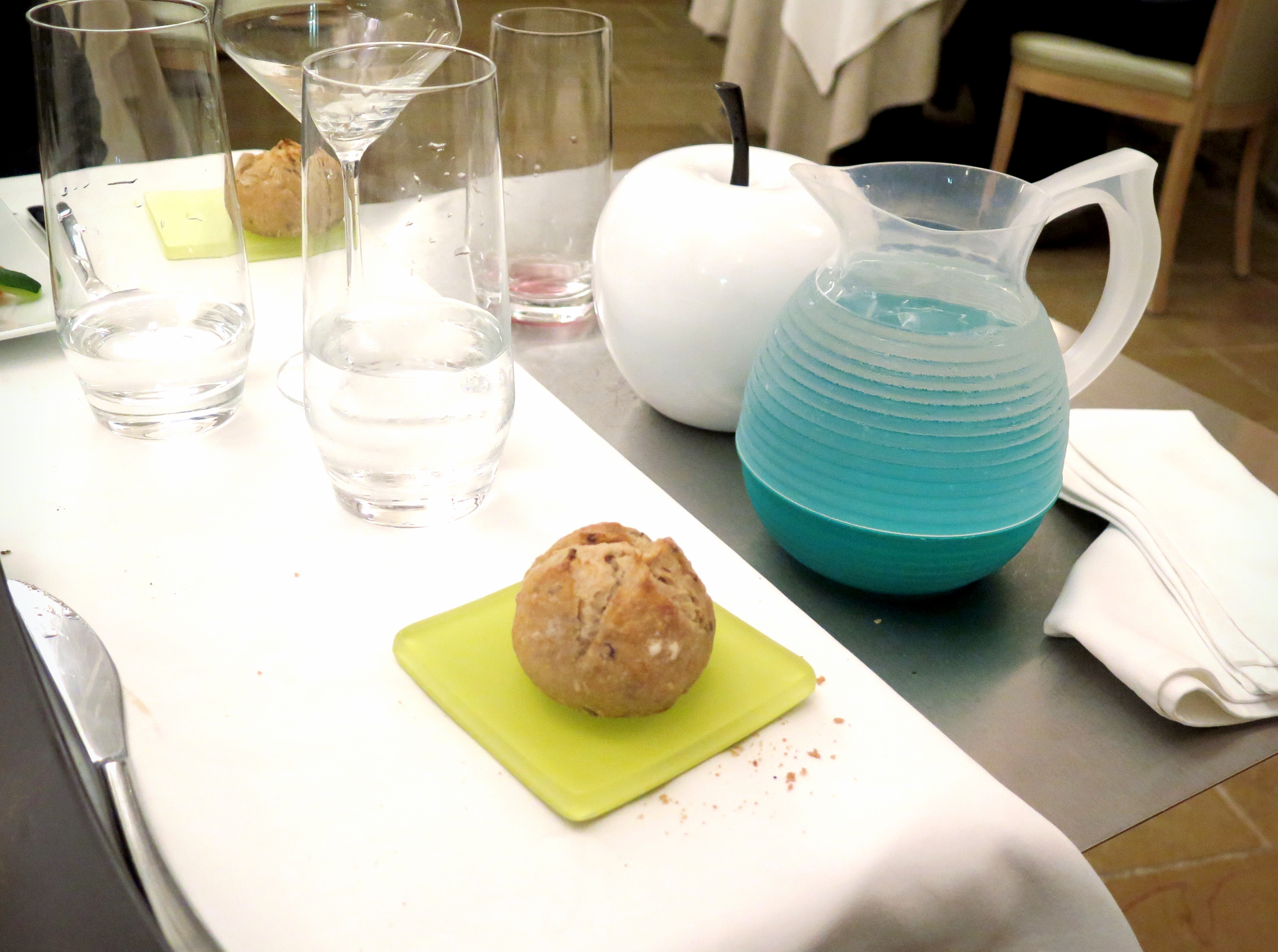 Stunning blue plastic water-jug, aside useless decorative white apple.